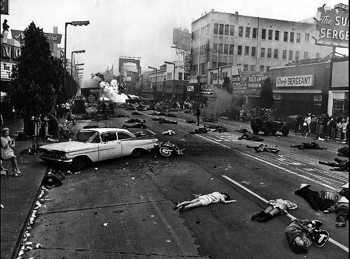 Sunday, Mary 24, 1970: War filmed on Hollywood Blvd. This view of 100 soldiers and civilan victims sprawled amid bursting bombs startled residents along Hollywood Blvd. between Las Palmas and Cherokee Aves early on a Sunday morning. Scene was in a dream-war sequence for the movie Alex in Wonderland. The producer said it was the first time police allowed closing of Hollywood Blvd. for filmmaking. Photo by Don Cormier/Los Angeles Times. For From the Archives.
